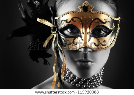 Stock Photo beautiful woman in mysterious mask
