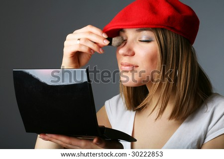 Beautiful woman in red cap. Make up