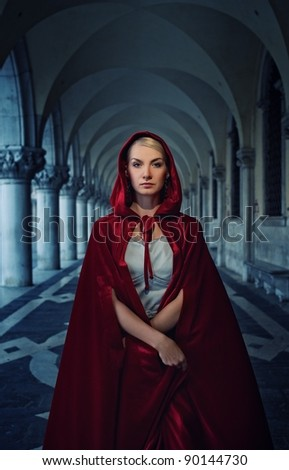 Beautiful woman in red cloak outdoor