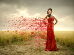 Beautiful woman in red dress with alphabet letters flying away from it