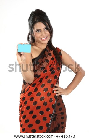 Beautiful woman in sari holding blue blank card