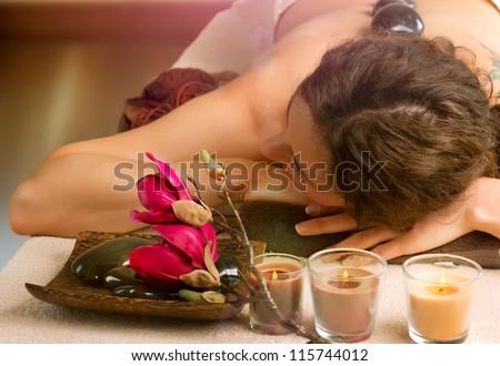 Beautiful Woman in Spa Salon. Spa Stone Massage. Day-Spa Treatment.