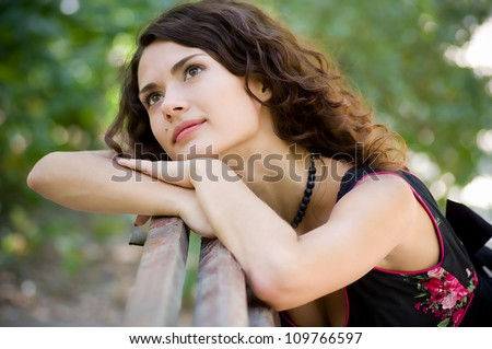 Beautiful woman in spring garden