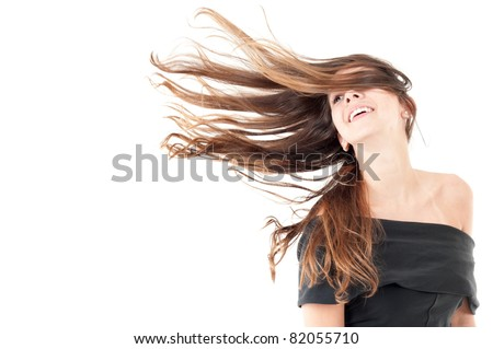 Beautiful woman in studio shot with wind on hair .