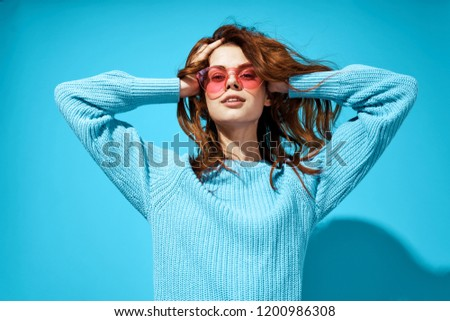 Beautiful woman in sunglasses in blue sweater