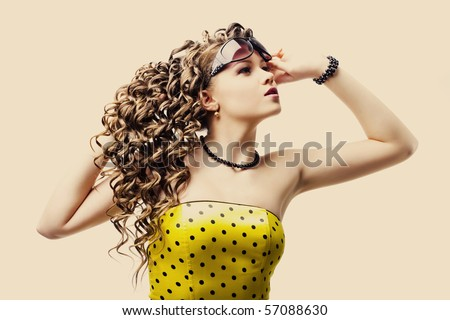 beautiful woman in sunglasses on white background