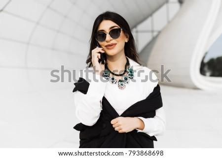 beautiful woman in sunglasses posing at the camera
