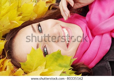 Beautiful woman in the autumnal garland from leaves