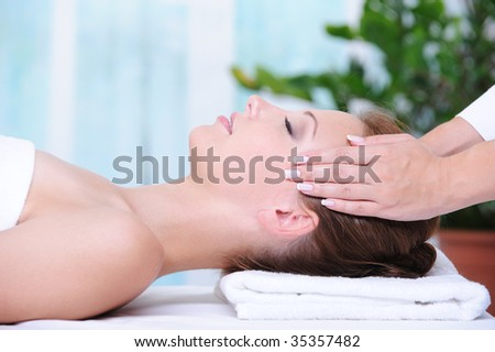 Beautiful woman in the beauty salon getting a face massage