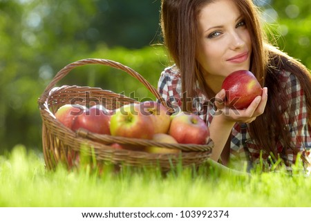 Beautiful  woman in the garden with apples #103992374