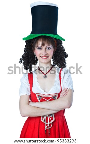 Beautiful woman in the red dress wearing a Saint Patrick's Day hat