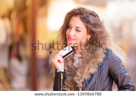 Beautiful woman in the street before shoping #1369866788