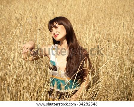 beautiful woman in the wheat field - stock photo
