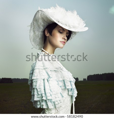 Beautiful woman in vintage dress on nature