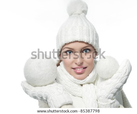 beautiful woman in warm clothing with snowball closeup portrait