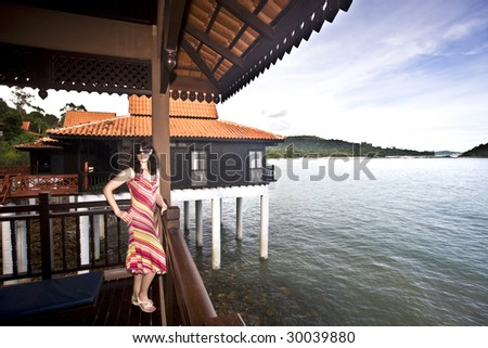 Beautiful woman in water house. Ecotourism.
