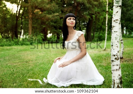 Beautiful woman in white dress outdoors in summer