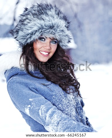 Beautiful woman in winter clothing - stock photo