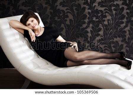 Beautiful woman is sitting on the couch