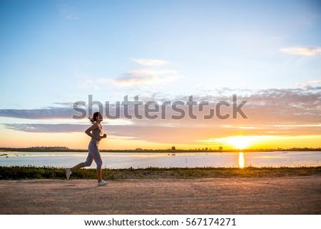 beautiful woman jogging in the...