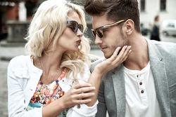 Beautiful woman kissing her boyfriend