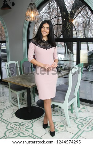 Beautiful woman lady spring autumn collection glamor model fashion clothes wear office style for date dress pretty face dark natural hair accessory bag casual business uniform dress pretty face .