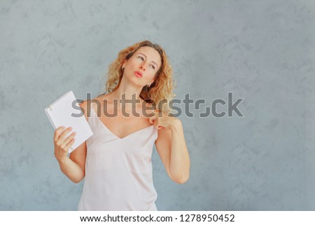 Beautiful woman languishes in heat / in a woman over forty menopause / copy space
