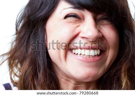 Beautiful woman laughs out loud with joy