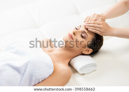 Shutterstock Beautiful woman laying on a mat in massage salon.