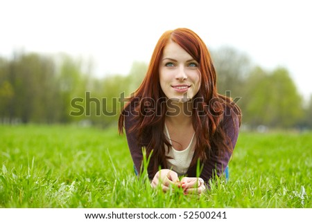 beautiful woman laying on grass