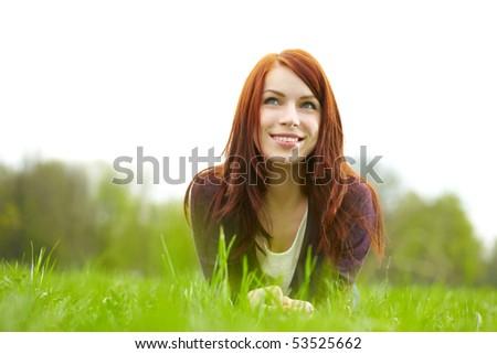 beautiful woman laying on grass