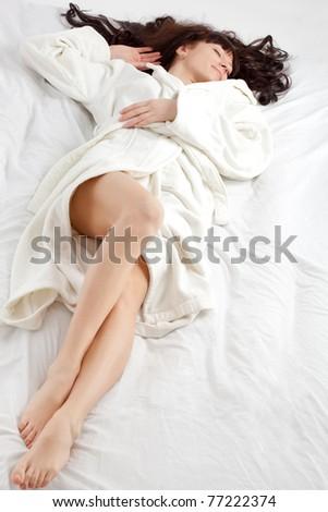 beautiful woman laying on white bed #77222374