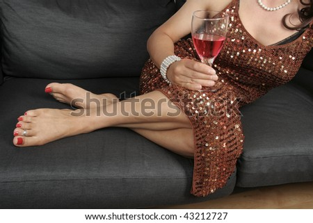Beautiful woman  legs with drink relaxing