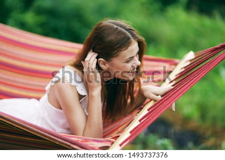 beautiful woman lies hammock nature relaxation travel relaxation