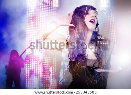 Beautiful woman listening music with live band background. Concept background of live music and party