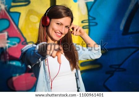 Stock Photo Beautiful woman listening to music on red headphones