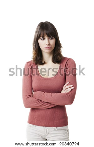 Beautiful woman looking angry and frustrated. Studio shot with with isolated white background.