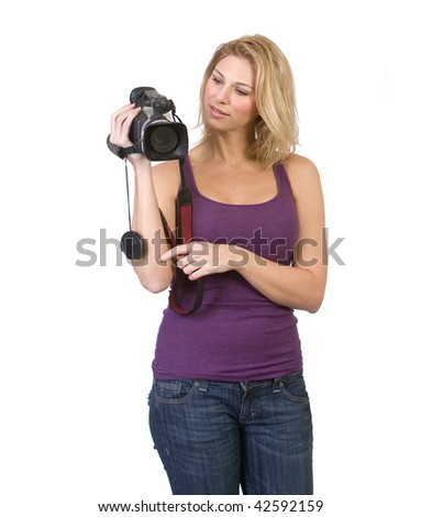 Beautiful woman looking at and holding a camcorder