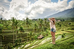Beautiful  woman looking at beautiful tegallalang rice terrace in Bali, Indonesia