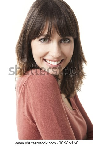 Beautiful woman looking at the camera, isolated on a white background