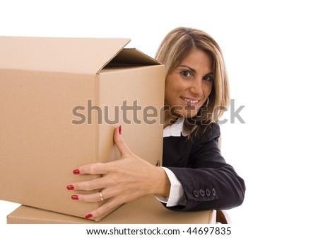 Beautiful woman looking behind a cardboard box