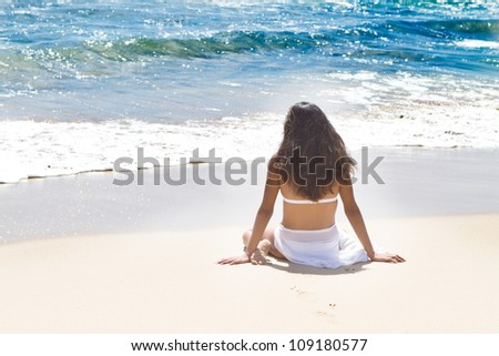 Beautiful woman looking into the Ocean in Hawaii