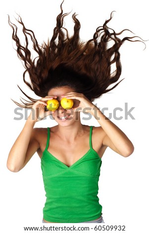 Beautiful woman lying and hold lemons near eyes and hair is dishevelled isolated