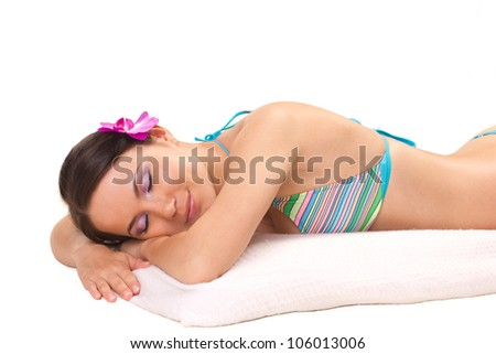 beautiful woman lying on a white towel isolated on white