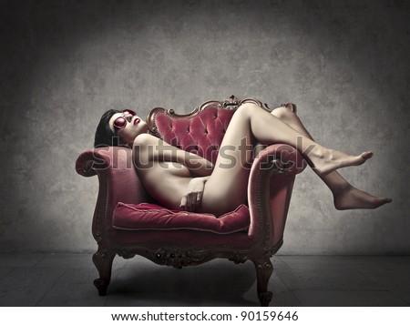 Beautiful woman lying on an armchair