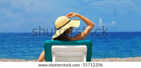 Beautiful woman lying on the beach ( lots of copy space )