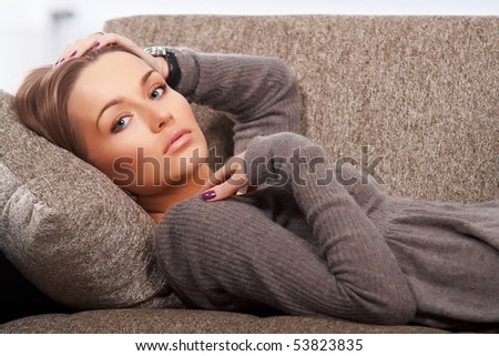 Beautiful woman lying on the couch