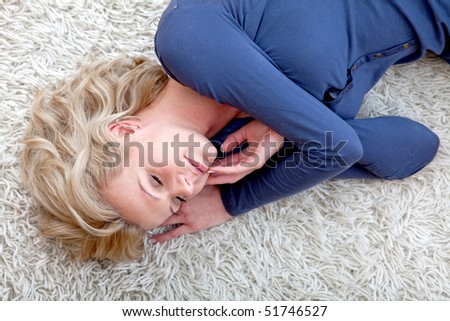 Beautiful woman lying on the floor at home