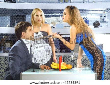 beautiful woman makes a scene to the groom at restaurant - stock photo