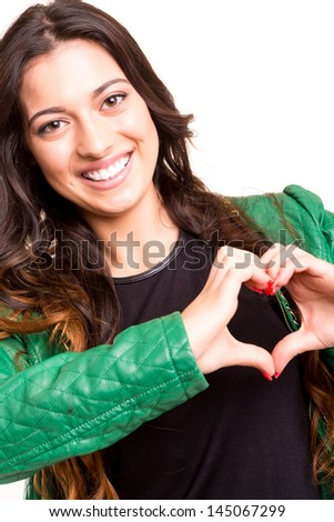 Beautiful woman making a heart shape with her hands, isolated over white background